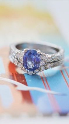 This three stone sapphire engagment ring is stunning.