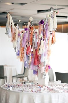Fun garland of fabric/paper tassels!  Easy to make, can mix in different materials and creates texture, dimension and fun to your event!