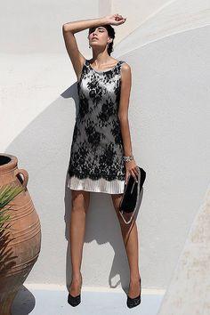 Linea Raffaelli - Short dress in black lace with a gold colored plissé layer