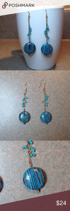 Cute, long, turquoise and gold colored earrings Super cute long dangly turquoise and gold colored earrings. 3.25 inches long including earring hook. This is super cute and super fun pair that is sure to wow!  These are new and never worn Jewelry Earrings