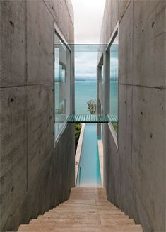 Not too crazy about the plain concrete outside, but this is how I want my house attached to yours. Perfect snorkeling and hobbie cat frontage!