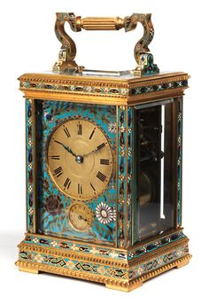 Carriage clock Height: 19 cm. Base width: 10 cm. Height of the case: 20 cm. Width of the case: approx. 12.5 cm Russia, 19th century. Good overall condition. Working order not tested. With one key. Leather case included in lot