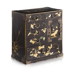 SMALL JAPANESE LACQUER AND SHIBAYAMA CABINET MEIJI PERIOD the front divided into multiple drawers and compartments decorated in gilt, ivory and mother of pearl with scrolling vines and butterflies, the door to one compartment with birds in flight over pagodas, one side with lilies and a bird in flight, the other with a cricket perching over leafy branches, the top decorated with a group of fans, the metal mounts carved with scrolling leaves, the interior with maki-e lacquer decoration