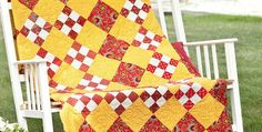 Perfect for Picnics and Other Summer Activities! Vivid reds against yellow give this quilt a festive air that will brighten any room it's displayed in. Splashes of white are the perfect accents. The quilt is an easy one to make, with simple nine-patches set on point with square blocks. It won't take long to finish …