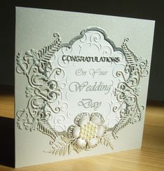 Wedding card made using Tattered Lace Venetian Fern die, Tattered Lace Venetian Fern Frame die, Tattered Lace Lavish Blooms Poppy die and Tattered Lace Lavish Blooms fern die. Background embossed with flourish swirl embossing folder and Tim Holtz embossing diffuser oval, Sentiment Tattered Lace Congratulations dies and remainder printed.