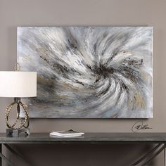 Mesmerizing, handpainted artwork on canvas features an array of earth tone colors. The canvas is stretched and applied to wooden stretchers. The Vortex artwork comes ready to hang. Due to the handcrafted nature of this artwork, each piece may have subtle differences.