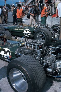 The Lotus pit with Jim Clark's 49 in the foreground and Graham Hill's behind…