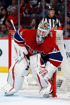 Budaj signed a two-year contract worth $2.3 million with the Montreal Canadiens on July 1, 2011. During the lockout shortened 2012–13 season, his second year as backup to Carey Price, Budaj carried an 8–1–1 record in 13 games, to earn a two-year contract extension with the Canadiens on April 10, 2013. On October 5, 2014, Budaj and Patrick Holland were traded to the Winnipeg Jets in return for Eric Tangradi. Ice Hockey Teams, Hockey Goalie, Hockey Mom, Hockey Players, October 5, July 1, Montreal Canadiens, Nhl, Goalie Mask