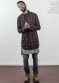 Long checked shirt with skinny jeans.