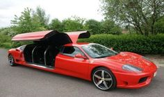 FERRARI SPORTS CAR STRETCH LIMO WITH HUGE GULL-WING DOORS!
