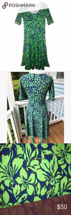 "LuLaRoe Nicole Dress LuLaRoe's Nicole dress boasts a fitted bodice, flattering scoop neck, mid-length sleeves, & a full circle skirt. It is simultaneously casual, dressy, & feminine! It is the sort of dress that brings out all that is girl in you - & we know you will not be able to resist giving it a twirl. Fun & fashionable? Yes, please.  Never worn w/ tags attached! Green & blue nature print with red flecks.  Measures: 39"" in length & 17.25"" armpit to armpit -please keep in mind this dress…"