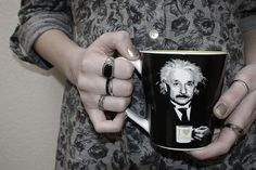 """Not my hands, but I do own this mug and it's my favorite one to drink from...on the handle is says """"Coffee Makes Me Smart"""""""