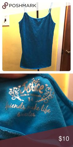 Justice girls Cami In beautiful teal color. Girls size 14 justice Cami. My daughter wore this a couple of times, maybe twice. No stains or tears and cumbersome a smoke free home. Justice Tops Tank Tops