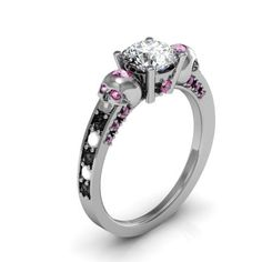 Not to much a fan of the sides. Probably just do regular diamonds. But def keeping the pink! - Skull Engagement Ring.