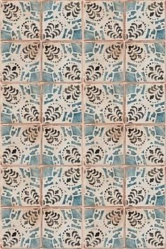 Handmade tiles can be colour coordinated and customized re. shape, texture, pattern, etc. by ceramic design studios Painted terra cotta tile