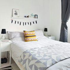 Fresh white, black bedroom with little display shelf. Found on Housetohome.co.uk