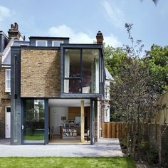 For the Milman Road renovation, the team at Syte Architecture referenced the past while assembling the two-story addition, cladding the exterior in zinc and reused brick from the original wall so it blended with the express chimneys and surrounding structures.