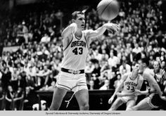 Black and white photo of University of Oregon basketball player Gene Brockmeyer passing the ball during a 1966 game played at McArthur Court. ©University of Oregon Libraries - Special Collections and University Archives