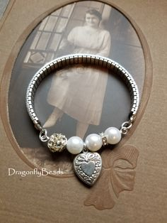 Assemblage style bracelet with a vintage Speidel watch bracelet, vintage engraved heart and repurposed pearl beads. by DragonflyBeads $25.00