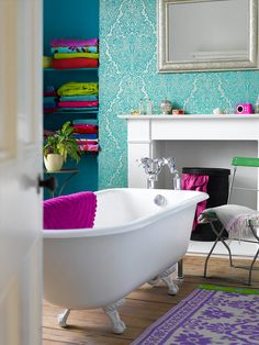Knock-your-socks-off vibrantly bright bathroom with turquoise, purple, chartreuse, & hot pink