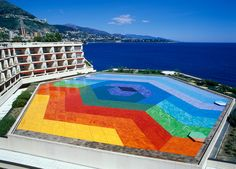 """Overlooking the sea, Monaco's performing arts center Auditorium Rainier III has a bright surprise on its roof. The """"Hexa Grace"""" was completed in 1979 by Op-Art artist Victor Vasarely and is a geometric wonder. Read more at Visit Monaco »   - HouseBeautiful.com"""