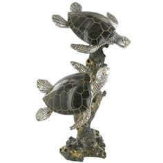 """Sea Turtles Swimming sculpture features beautiful detailing and highly polished metallic finishes that are sure to add an elegant touch to home or office decor. It measures approximately 8"""" wide x 12 1/2"""" tall x 6"""" deep."""