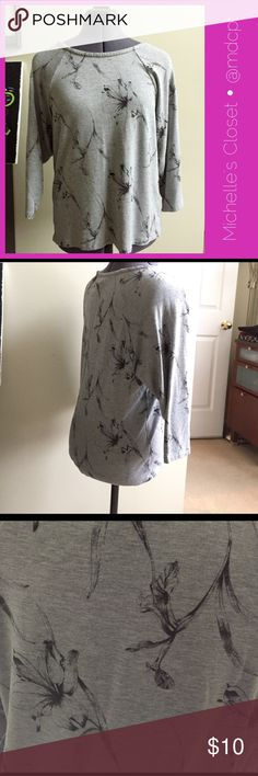 """Floral knit shirt NWOT Never worn but tags removed. Soft knit, 3/4 dolman sleeves, 21"""" long, 20"""" bust.  Perfect muted way to welcome spring with lillies and foliage. Forever 21 Tops"""
