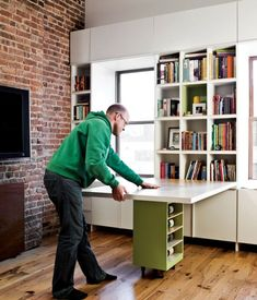 The Transformer Apartment Shows You How To Save Space In A Tiny Home Wall of the built in folds down and the square top of the rolling end table supports it! INGENIOUS!
