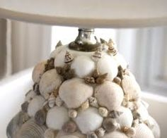 Coquillage: gluing shells onto a repurposed item (this is an ugly 1950s lamp sprayed white and covered with shells)