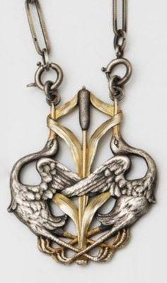 An Art Nouveau silver and vermeil pendant, circa 1900. Pendant length: 6cm. #ArtNouveau