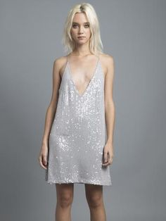 Our favorite paired with our favorite detailing, sequins. Add some glitz to your wardrobe with this bad girl dress. With a halter V neck line and low back you'll sure be workin' the dance floor pairin