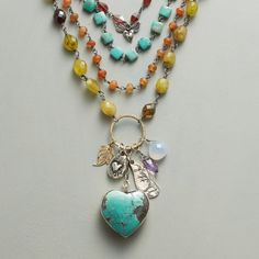 """HEARTFELT NECKLACE--A necklace with heart and soul, made by Jes MaHarry and bearing a plump turquoise heart, blue chalcedony and amethyst, inscribed sterling silver charms, a 14kt yellow gold leaf and tiers of carnelian, turquoise, red and green garnet. Soft suede ties. USA. Exclusive. Approx. 40""""L."""