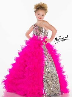 Eye-catching, stunning and glittering describe the beauty of this little girls pageant gown. Mac Duggal has the pleasure to dress your little girl in this Sugar 42877S featuring a fully rhinestone and sequin bodice with fun beaded detail on the side of the trendy one shoulder strap. Playful wire spirals along the ruffled full skirt make this dress the number one trend. A split of sequins adds a pop of glitz in the skirt. Complete her look with pageant shoes and accessories at…