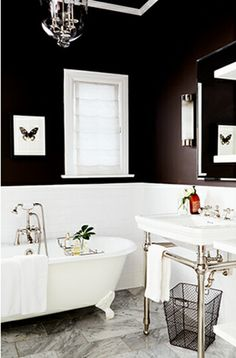 Black and white bathroom...would he kill me if I did this?? I love the idea of black on top of the existing white tile!
