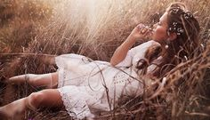 Lounging in a field, Chloe Lecareux  models white lace