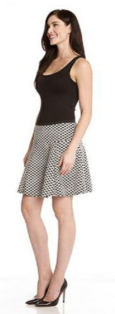 DESERT WEAVE FLARE SKIRT This flared skirt from Karen Kane is the perfect partner for blousy tops or fitted tanks with its flirty shape and bold pattern. #Karen_Kane #Desert_Weave #Skirt #Summer_2014 #Fashion