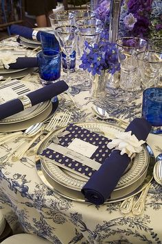 Table Design - Settings and Napkins / Navy blue toile tablecloths are accented with navy blue napkins and one of two menu patterns.