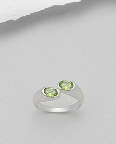 Inel deosebit argint - cristale pretioase de peridot Inel deosebit realizat din argint 925 decorat cu cristale pretioase de peridot. Placat cu rodiu - aspect de aur alb. Latime maxima: 5,5 mm. Marimi disponibile: 6,7 (SUA). Aur, Silver Rings, Jewelry, Jewlery, Bijoux, Schmuck, Jewerly, Jewels, Jewelery