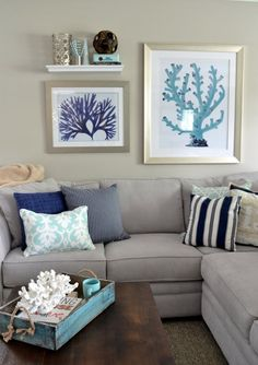 A suburban ranch in Illinois goes #coastal, with blue and #coral motif. For more coastal home tours, click here: http://www.completely-coastal.com/search/label/House%20Tours, coastal living room