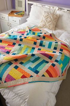 Use a collection of warm and cool prints to create contrast between the blocks in this throw-size quilt pattern called Belle Prairie, by Kristin Lawson. The blocks are set on point with solid sashing, cornerstones, and borders to separate and define them. Use batik fabrics for an exciting finish! Scrappy binding completes the look.