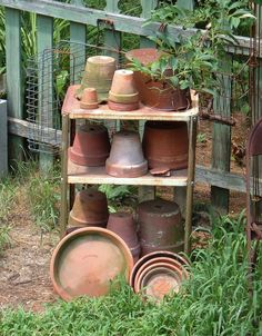 The old kitchen trolley has just the right amount of rust and is perfect to corral the flower pots.