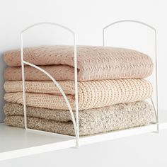 Provide structure and intentionality to a shelf by using these handy dividers. Sweaters on a shelf never looked so good.