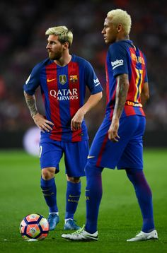 Lionel Messi (L) and Neymar Jr. of FC Barcelona look on during the La Liga match between FC Barcelona and Deportivo Alaves at Camp Nou stadium on September 10, 2016 in Barcelona, Spain.