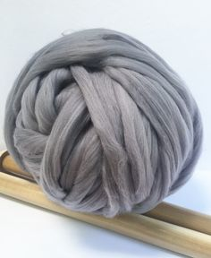 This chunky yarn is very thick, about 2 inches stitch. It is very soft and gentle to touch. It is Merino wool blend, 50% Merino/50%Acrylic. It looks and feels like Merino but it is a cheaper alternati