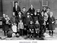 Russian immigrant family in Ellis Island, 1929 Stock Photo Russian American, American Girl, First Red Scare, Ellis Island Immigrants, Volga Germans, Society Problems, Vintage New York, Photographs Of People, Us History