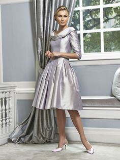 A timeless feminine Mother of the Bride & Mother of the Groom dress from the Portofino 2016 Collection by Ian Stuart London. This dress features a cowl neckline and has been beautifully designed using a silk dupion metallic fabric. Product code ISL565.  View more Mother of the Bride / Groom dresses from our Ian Stuart collection at: http://www.baroqueboutique.co.uk/mother-of-the-bride-south-wales/  Photographs courtesy of:  http://www.ianstuart-london.com/