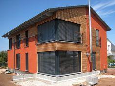 Einfamilienhaus modern holzhaus flachdach garage mit for Bausatzhaus holz