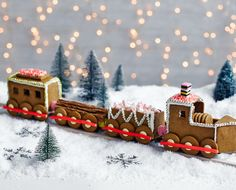 This fun and festive gingerbread train is packed with all your favourite treats - soft pink and white marshmallows, chocolate flakes, strawberry pencil wheels and liquorice allsorts. | Tesco