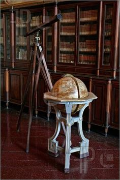 always wanted an antique globe--and a wonderful library to put it in.