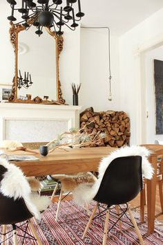 don't like the mirror or the chandelier; DO like the centerpiece, stacked wood, table, chairs, and rug.